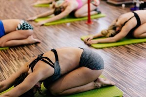 womans yoga group stretching