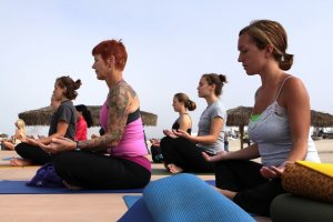 womans yoga group meditating